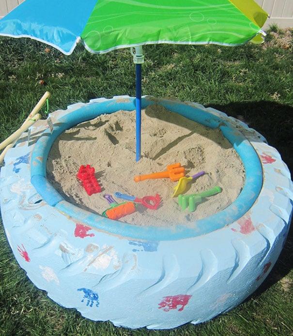 Gumiabroncs homokozó